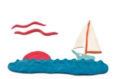 Tramonto del Plasticine in mare Fotografie Stock