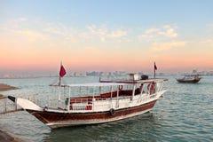 Tramonto del Qatar della baia di Doha Immagine Stock