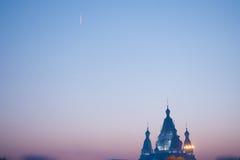 Tramonto della siluetta del castello della neve Fotografie Stock