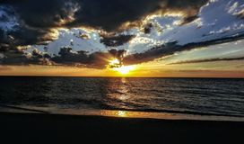 Tramonto Devon della spiaggia immagini stock