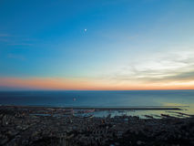 Tramonto di Genova sul porto Fotografia Stock