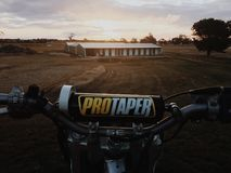 Tramonto di motocross Fotografie Stock