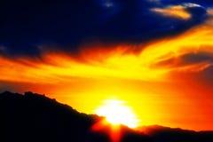 Tramonto e cielo nuvoloso Immagini Stock