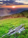 Tramonto e collina Fotografie Stock