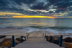 Tramonto ed oceano Fotografia Stock