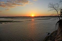 Tramonto lungo il fiume di Rufiji, riserva di caccia di Selous, Tanzania Fotografia Stock