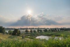 Tramonto nel fiume Po di delta dell'Italia Fotografia Stock