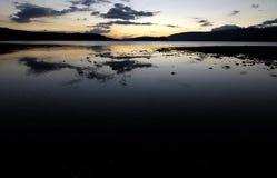 Tramonto nel lago Fotografia Stock