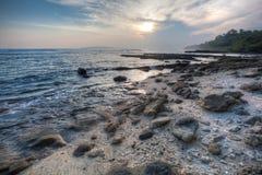 Tramonto nella spiaggia Immagine Stock Libera da Diritti