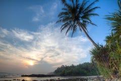 Tramonto nella spiaggia Fotografie Stock Libere da Diritti