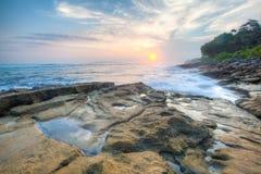 Tramonto nella spiaggia Immagini Stock Libere da Diritti