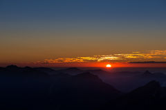 Tramonto nelle alpi austriache della montagna Immagine Stock