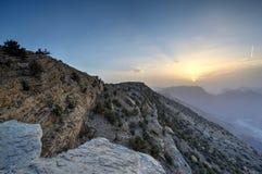 Tramonto nelle montagne dell'Oman Fotografie Stock Libere da Diritti