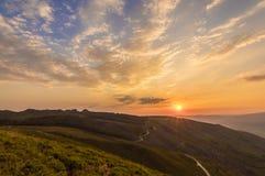 Tramonto nuvoloso Fotografie Stock Libere da Diritti