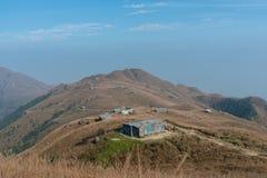 Tramonto Paek con la casa di pietra in Hong Kong Immagine Stock