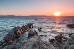 Tramonto rosso su Mykonos uno Immagine Stock