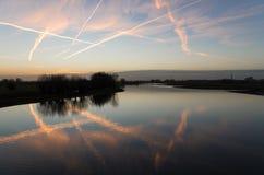 Tramonto sopra il fiume Fotografie Stock Libere da Diritti