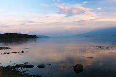 Tramonto sopra il lago di lugu, Dali, il Yunnan, Cina fotografie stock