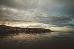 Tramonto sopra il mare Immagine Stock