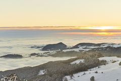Tramonto sopra la neve Fotografia Stock