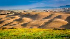 Tramonto sopra la valle in Toscana Fotografia Stock