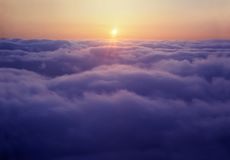 Tramonto sopra le nubi Immagini Stock Libere da Diritti
