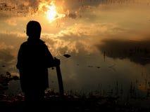 Tramonto su un lago Fotografie Stock