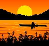 Tramonto su un lago Fotografia Stock