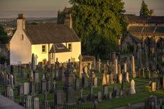 Tramonto su una casa del cimitero Fotografia Stock