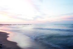 Tramonto su una spiaggia Fotografia Stock