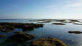 Tramonto su una spiaggia Fotografie Stock