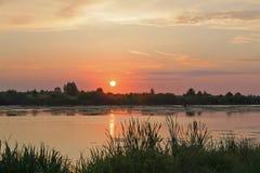 Tramonto sul fiume Fotografie Stock