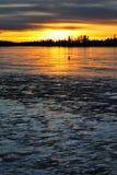 Tramonto sul lago del ghiaccio fotografia stock