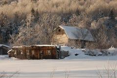 Tramonto sul vecchio fabbricato agricolo Immagine Stock