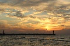 Tramonto sulla riva di mare, Fotografie Stock