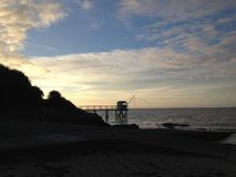 Tramonto sulla spiaggia Fotografia Stock