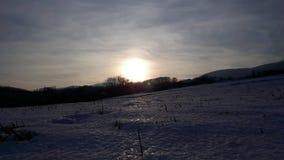 Tramonto sulla terra della neve Immagine Stock