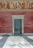Tramp sleeping at the door of  the National and Kapodistrian University of Athens Royalty Free Stock Photos