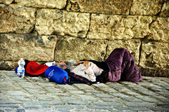 Tramp sleeping under the bridge of Triana in Seville 2 Royalty Free Stock Photo