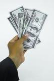 Trampa con los billetes de dólar aislados sobre el fondo blanco, riesgo en el negocio, hombre de negocios que toma el dinero de u Foto de archivo libre de regalías