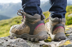 Tramping boots on a stone. Two tramping boots bevore mountain landscape Stock Photos