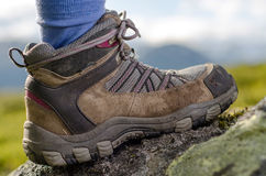 Tramping boots on a stone. Tramping boot bevore mountain landscape Stock Photography