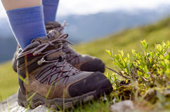 Tramping boots on a stone royalty free stock images