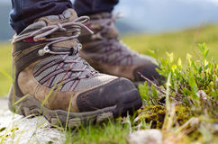 Tramping boots on a stone. Two tramping boots bevore mountain landscape Stock Images