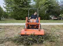 Tramping A Tree Limb Pile Down With A Front End Loader Royalty Free Stock Images