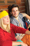 Tramping young couple backpack relax by cottage Royalty Free Stock Photography