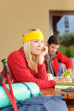 Tramping young couple relax by wooden table Royalty Free Stock Images