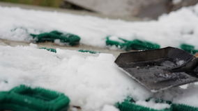 Trample snow shovel. Stomp the snow shovel to make it slippery stock video footage