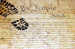 Trampled Constituion. A boot print or footprint on a copy of the constitution Royalty Free Stock Photography