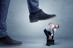 Trampled small businessman in suit Royalty Free Stock Photography